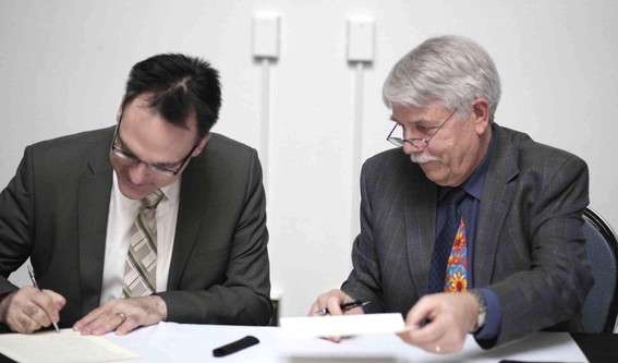 Vice President Academic Hank Bestman signing historical agreement with Newman Theological College