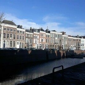 Narrow homes along canal in Amsterdam