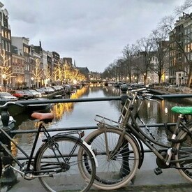 Bikes on bridge over a canal in Amsterdam