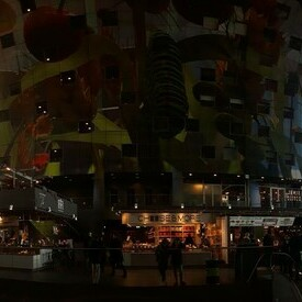 The Markthal in Rotterdam with a colourful domed ceiling.