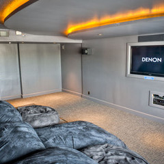 Movie lounge on floor 5 with large tv, tier beanbag chair seating and dimmed lighting