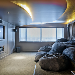 Floor 5 movie lounge with large tv and comfy beanbag chair seats.