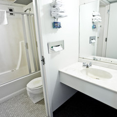 Residence room bathroom showing shower tub, toilet and vanity area.
