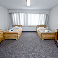 Residence room set up with two beds on either side in front of large window