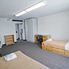 Residence room showing two beds and large wardrobe.
