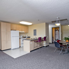 Kitchen area of apartment with table and kitchen bar.