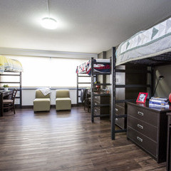 Triple occupancy room in the suite residence with loft beds and desks.