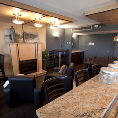 Floor 6 lounge with fireplace, cozy seating and kitchen bar.