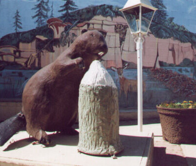 Giant brown Beaver with chewed log statue.