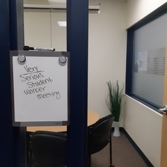 Whiteboard outside of office reads