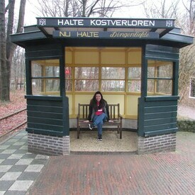 Student sitting at at train station in Europe.