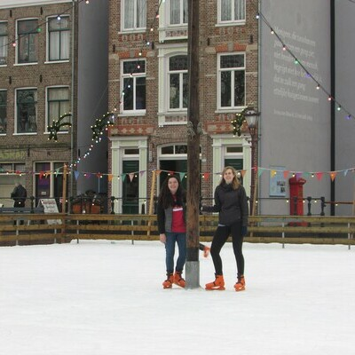 Students skate in bright orange skates at the outdoor museum.