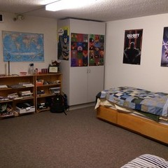 Residence room with posters hung on wardrobe