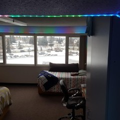 Colourful track lighting decorate a residence room.