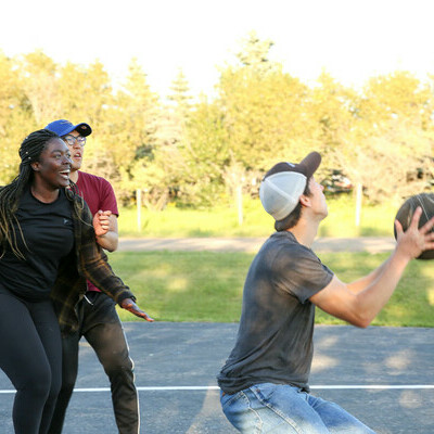 Students playing basketball at the Fall Retreat.
