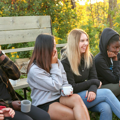 Students around a campfire at the Fall Retreat.