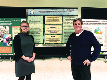 Abbigail Hofstede and Principle Investigator Dr. David Long with a poster presentation at a research event hosted by the University of Alberta Faculty of Extension