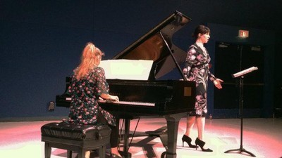 Two students performing a piano and voice concert in Knoppers Hall.