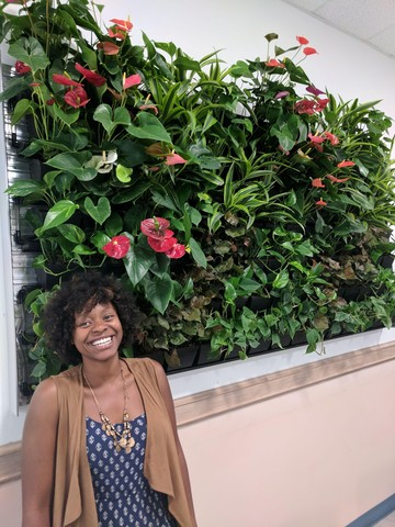 Charmaine with King's new green wall