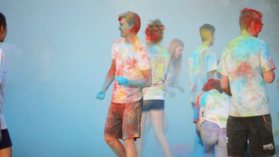 Students in white t shirts covered in colored powder at Colour Me Kings.