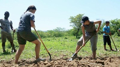 Students working create a gravity water system in Honduras.