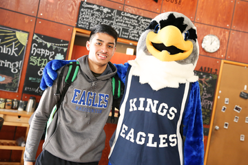 Narayan Ramdhani with Izzy the Eagle at the nationals pep rally