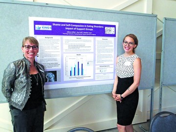 Executive Director Sue Huff with student Milena Miller at poster presentation, Pscyhologist's Association of Alberta Spring 2017.